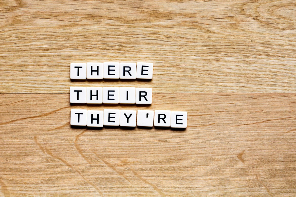 letter tiles showing the homonyms there, their, they're