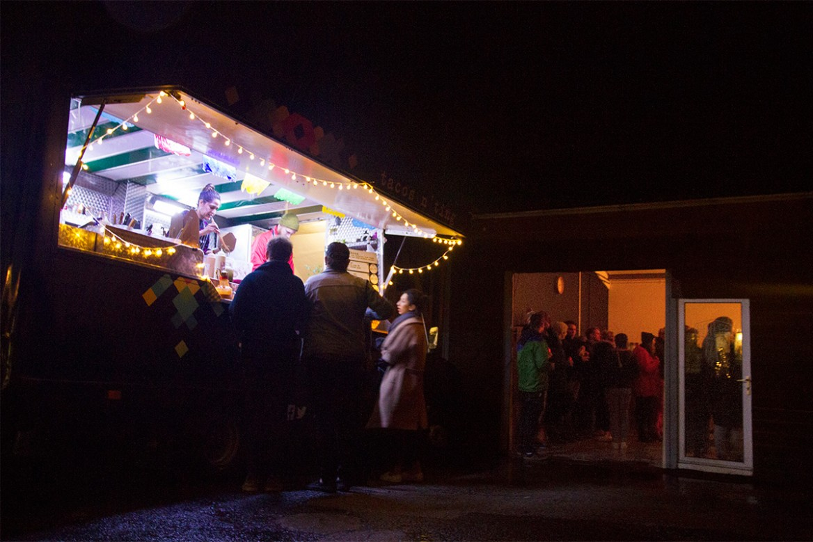 the el huecho taco food truck, lit by fairy lights, at the november 2017 as one talks event hosted by hailer