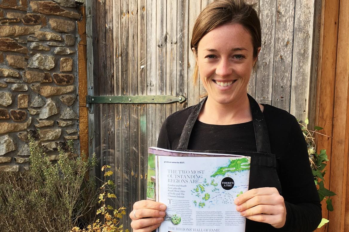 zennor pascoe of cusgarne organic farm shop holding up a magazine