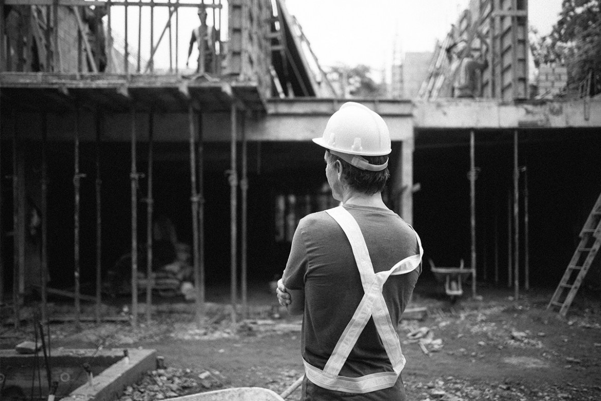 surf simply's founder ru hill observing the construction of surf simply's 2.0 surf coaching resort in costa rica