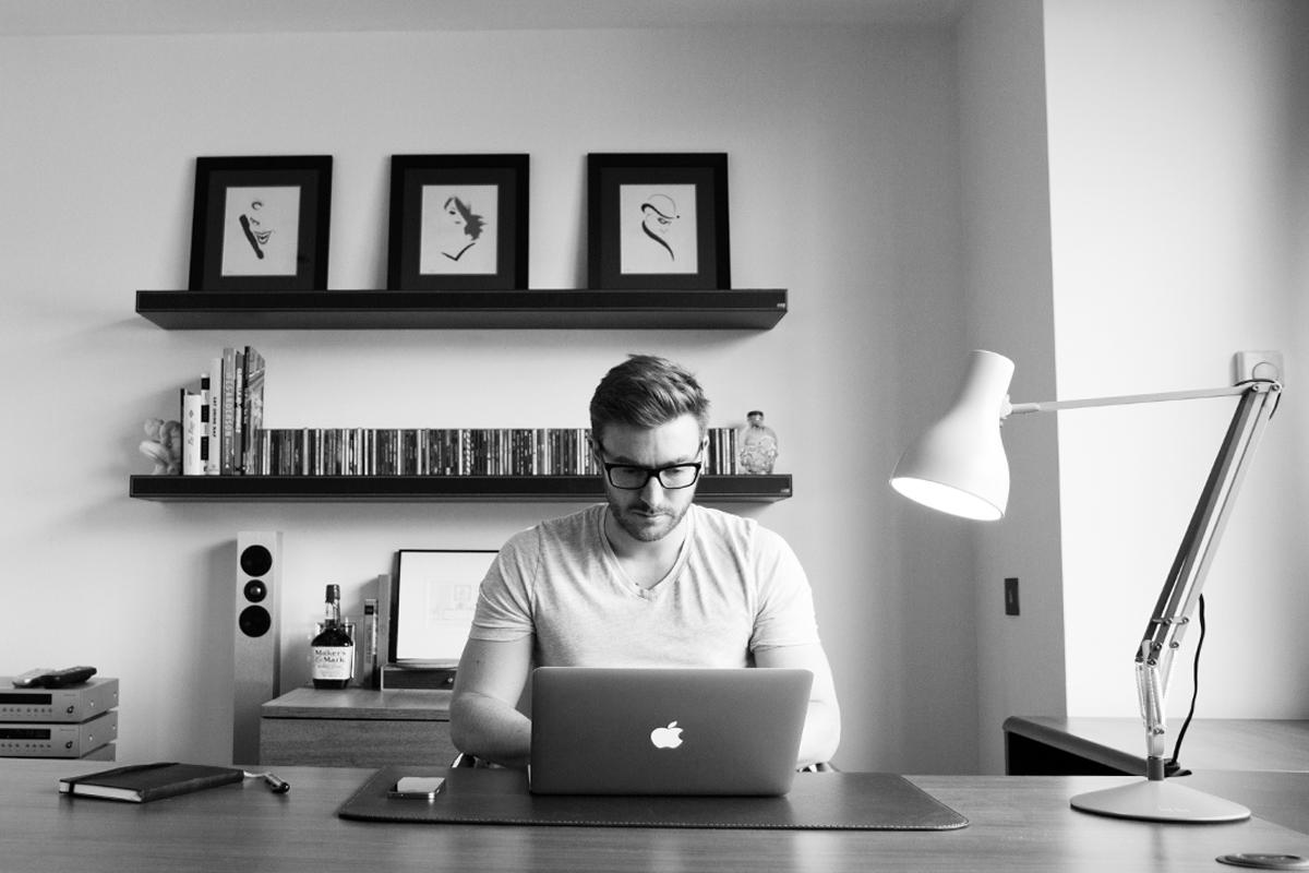alex wilson sat at his desk