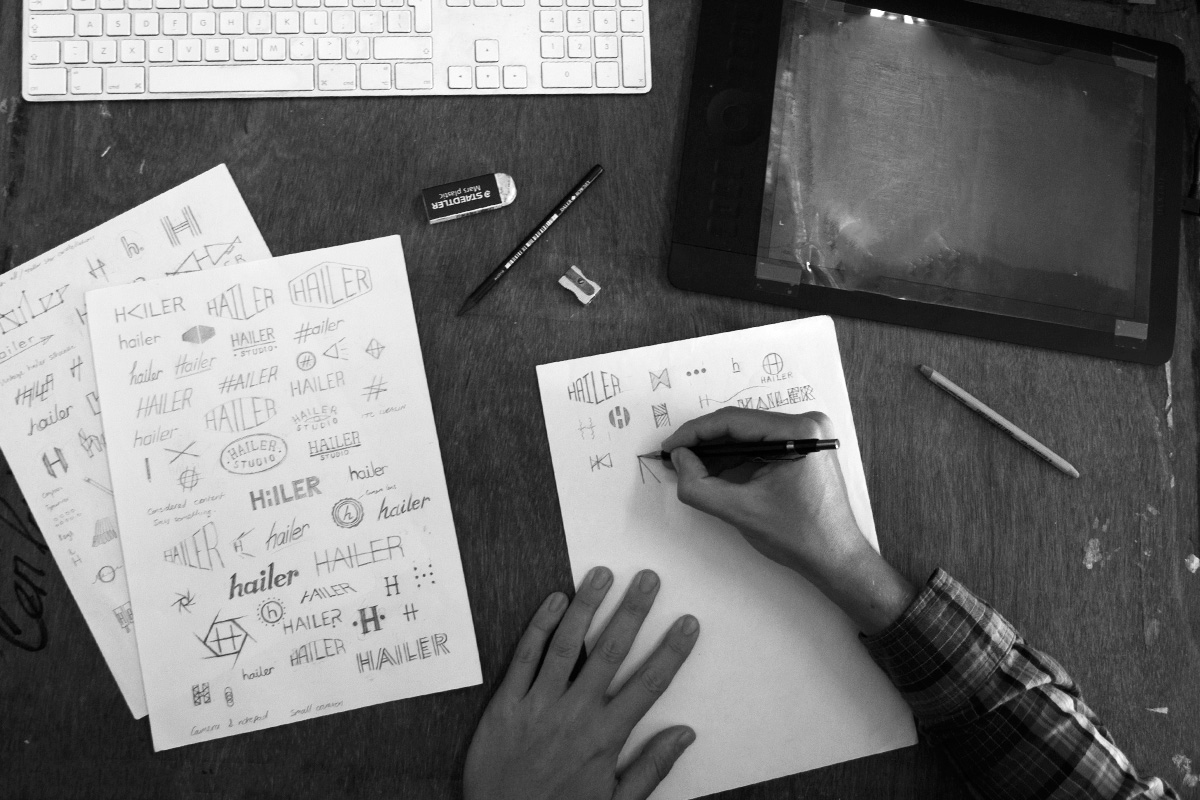 birds eye view of graphic designer ceri pashley sketching design ideas for the hailer logo