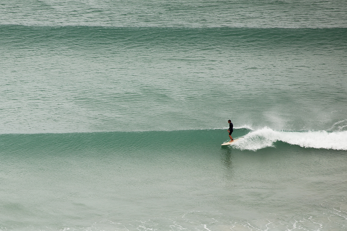 still of surfer marcus healan surfing the coaster wooden surfboard from otter surfboards video tealing
