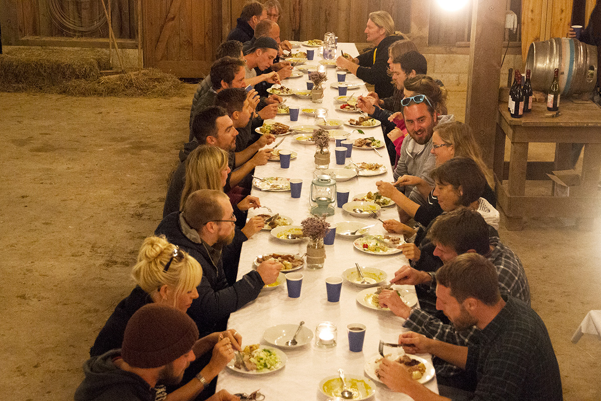 looking along the long feast table at the otter surfboards annual gathering of makers 2015