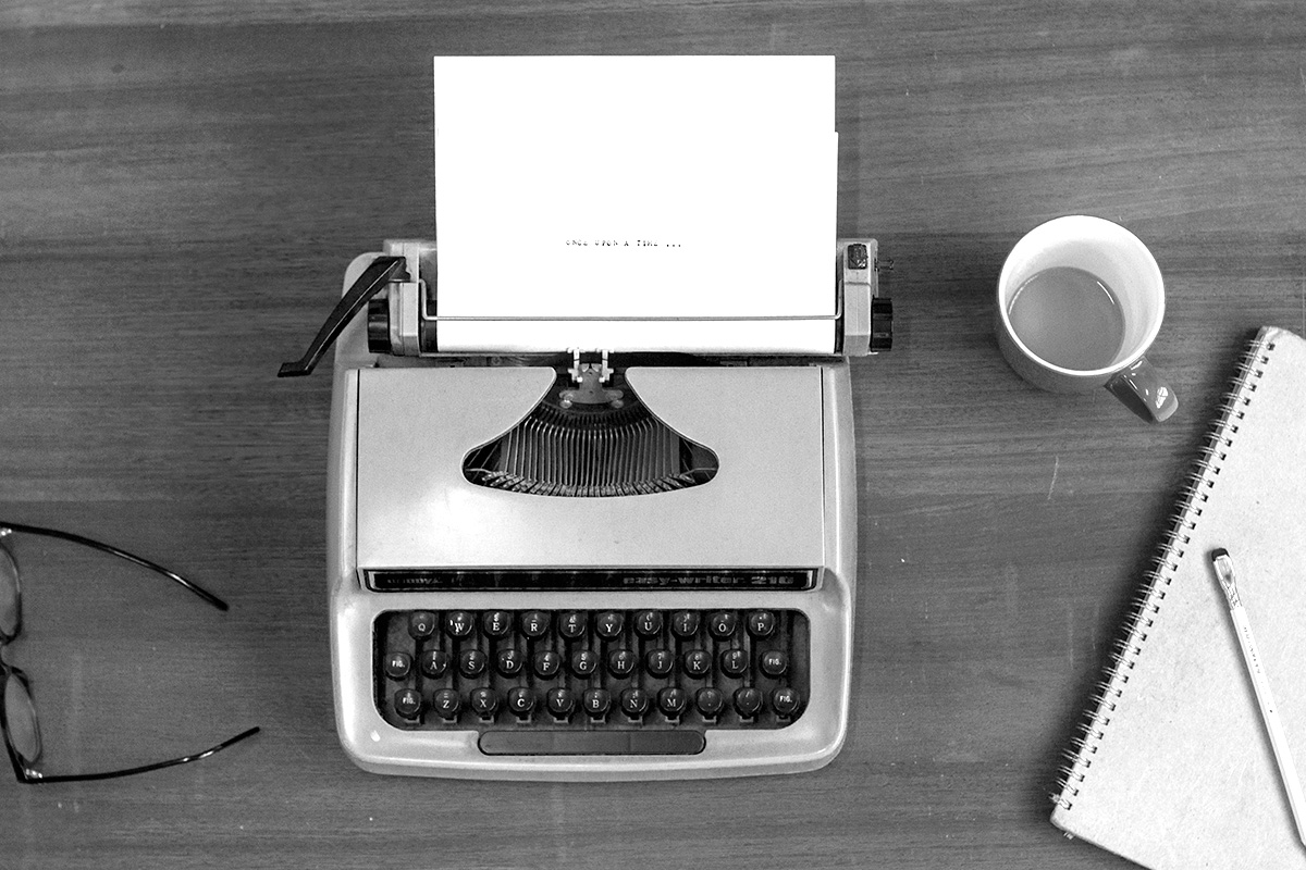 vintage typewriter and notebook on a writer's desk